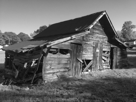 Black & white image of wooden shed.